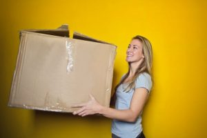 Woman relocating and holding a box