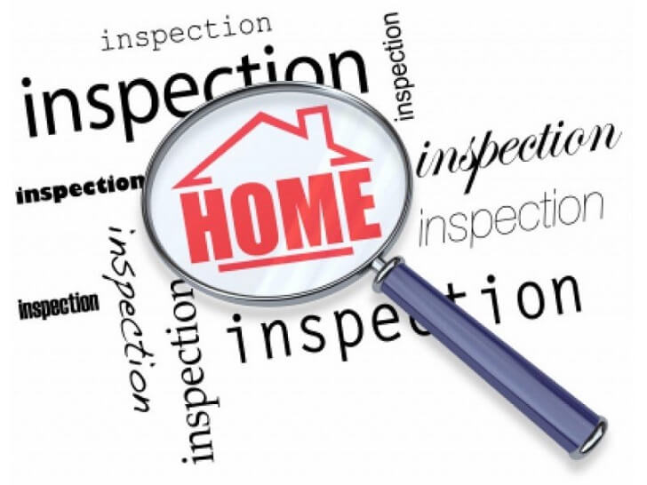 Home inspection sign with magnifying glass