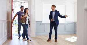 colorado buyers agent showing house to couple walking through red door