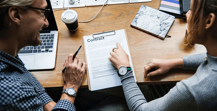 A-Buyer-Agent-with-a-Buyer-Discussing-the-Contract